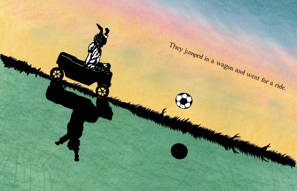 a boy in a wagon with a soccer ball
