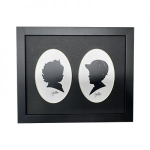 framed silhouettes of a boy in a cap and a girl with a bow
