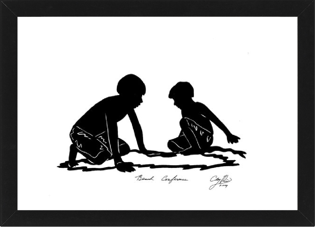 two boys playing in the sand