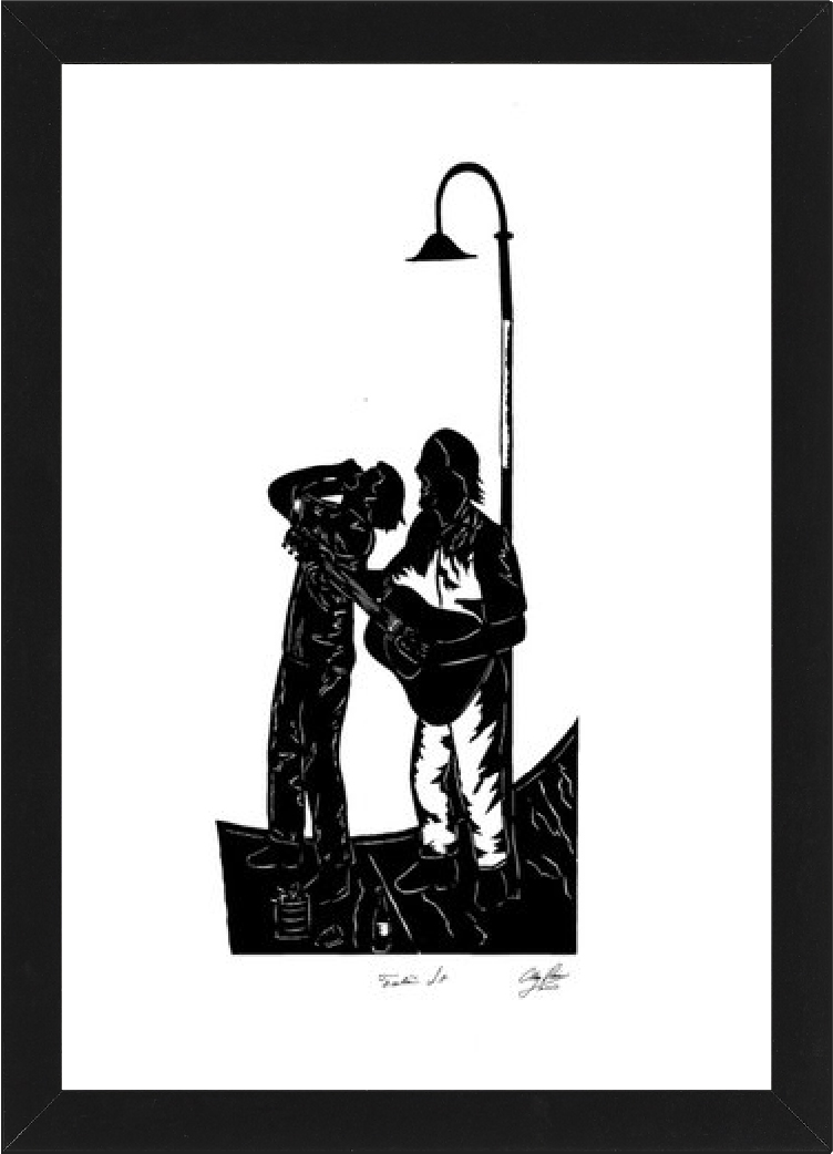paper cut out of man playing guitar while woman sings