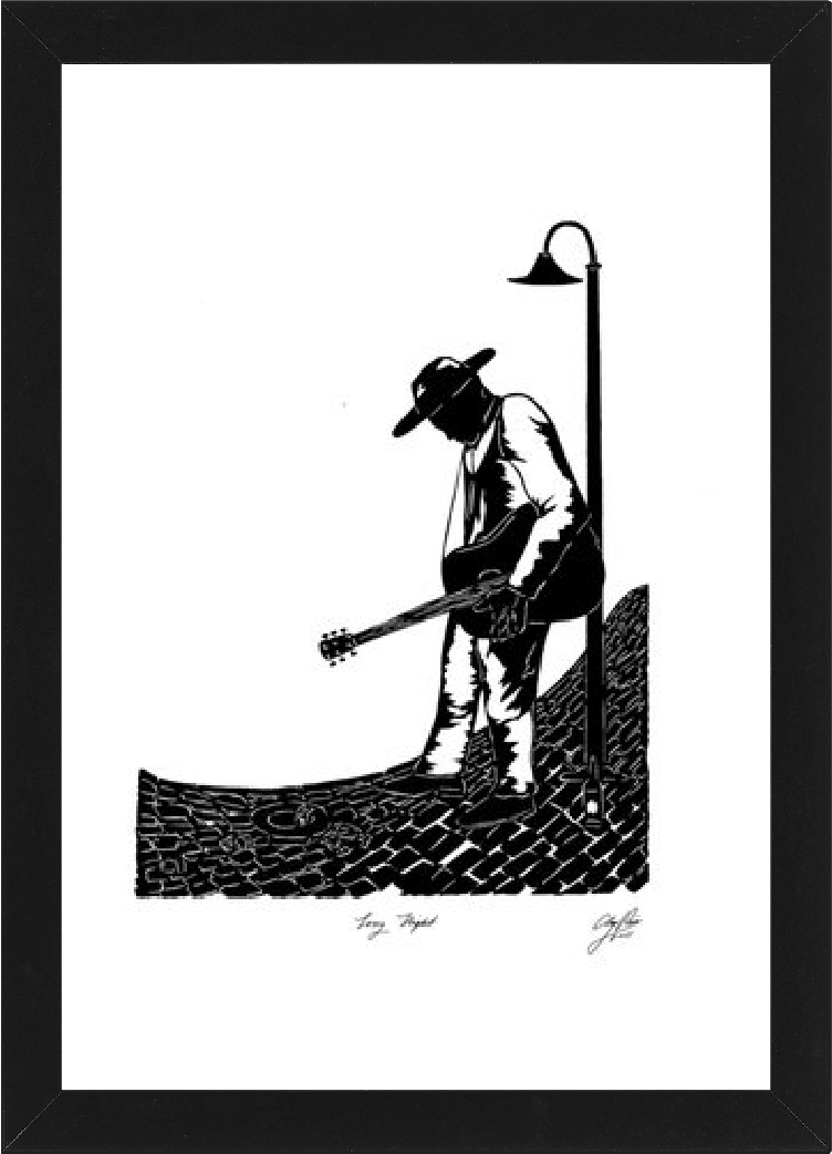 silhouette of a man playing guitar under a lamp