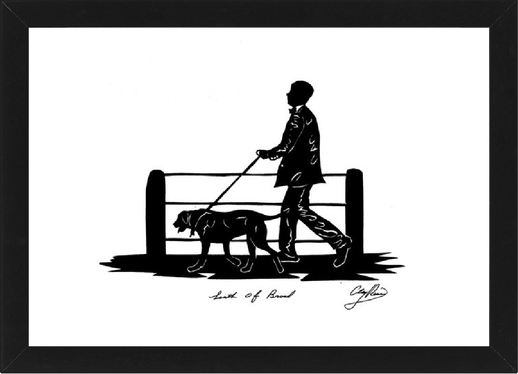 dressed-up man walking his dog in front of a fence