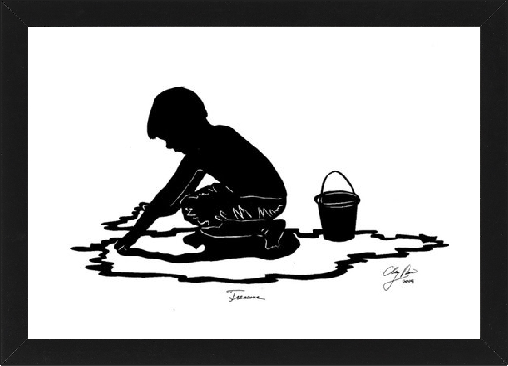 silhouette of a boy playing in the sand